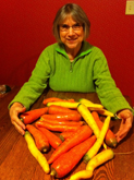 photo of woman with a lot of carrots