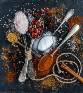photo of spoons overflowing with spices