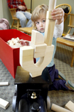 photo of a small boy stacking wooden blocks