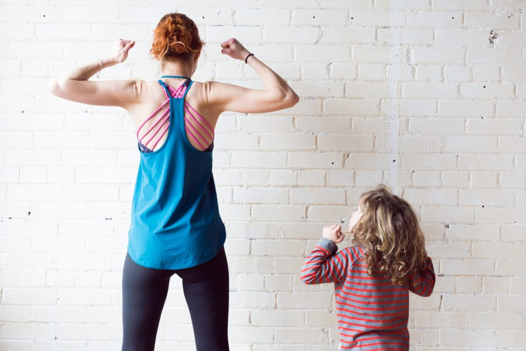Woman and child making a strong pose